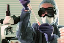 Medical and Pandemic image of scientist using vials