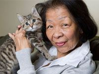 Aging Adult holding cat